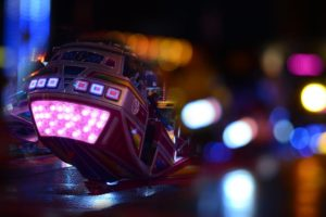 Black and Pink Speed Vehicle With Lights on Background