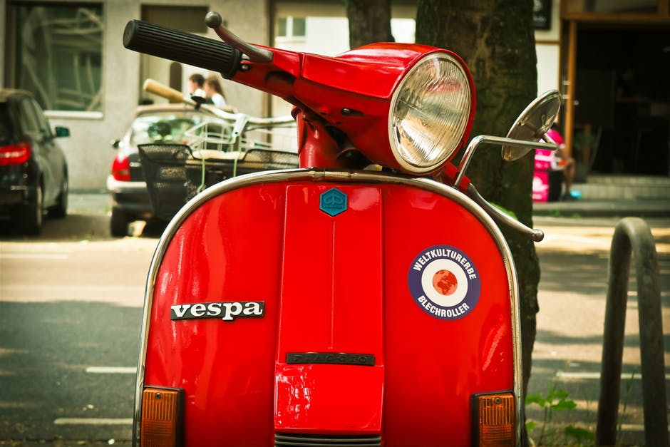 Red Vespa Motor Scooter Parked Near Tree During Daytime Wallpaper
