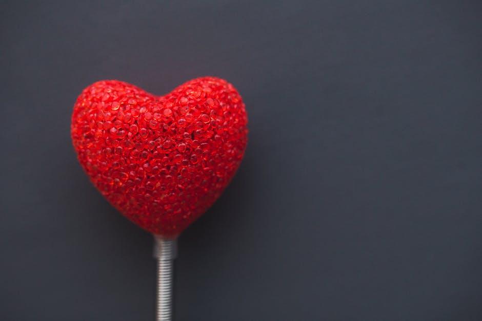 big red heart on dark background